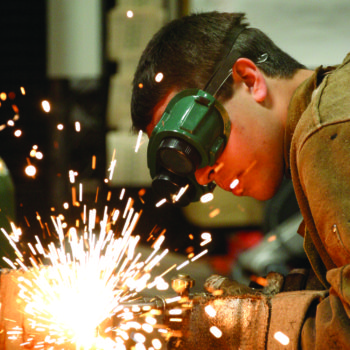 A student welds on campus at TMCC
