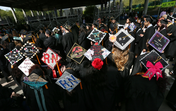 Nursing students show off their cap art during the 45th annual Western Nevada College Commencement ceremony