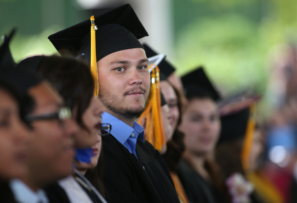 Graduate Dillon Hekhuis looks at the crowd during the 45th annual Western Nevada College Commencement ceremony