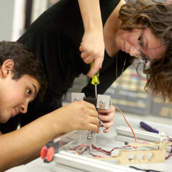 Students in a biorobotics course assemble the framework for a robot