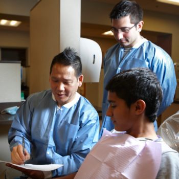 Students and faculty at the School of Dental Medicine