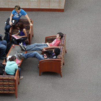 Students relax on the first floor of the Lied Library