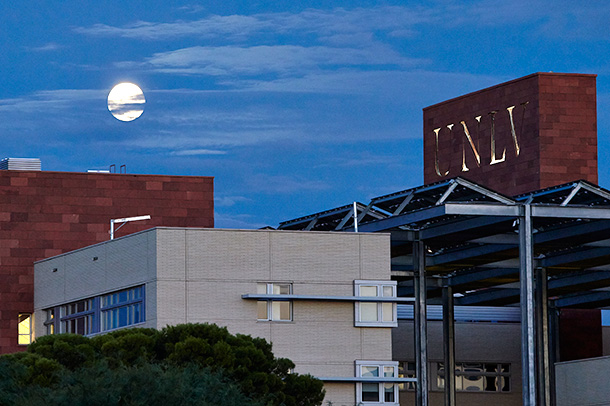The moon rises over Greenspun Hall August 20, 2013