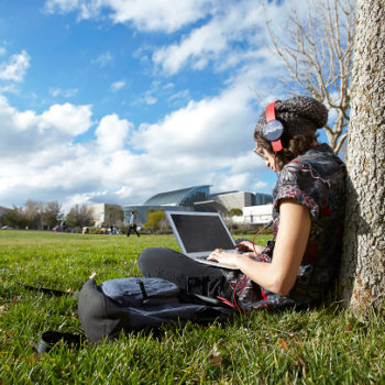 UNLV junior journalism major Ashelynne Morales soaks up the warm January sun while studying