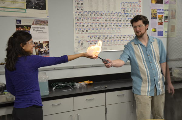 A professor demonstrates chemistry