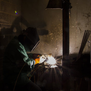 A student welds at GBC