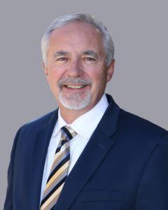 P. Mark Ghan, Acting President, WNC