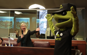 Assemblywoman Krasner pictured with the TMCC mascot.
