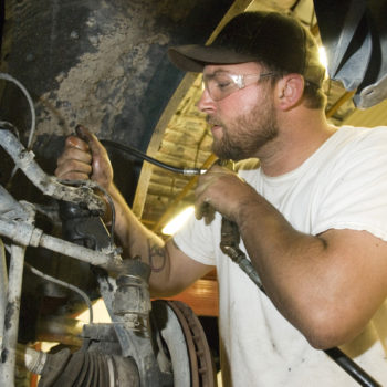 WNC automotive student Ronny Scharmann does a lube job on his truck.