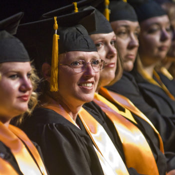 Graduates listen to the commencement address during the WNC Graduation in Fallon at the Barkley Theater.