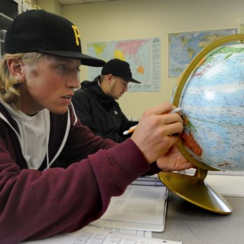Bobby Rappin, left, and Rayne Raven, both of Carson City, find different places on globes that have similar climates