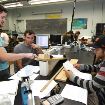 Physics instructor Thomas Herring talks with Dan Gonzales and Kyle Willens in class at Western Nevada College