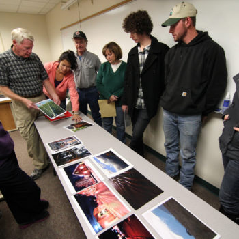 An instructor critiques photos with his class at the Douglas campus of Western Nevada College