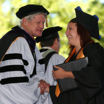 Regent Ron Knecht congratulates graduate Sarah Drinkwine at the 2013 Western Nevada College Commencement