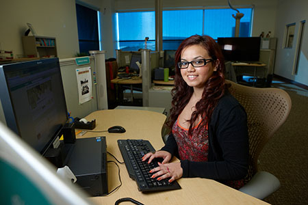 UNLV University Libraries Web and Digitization Services (WDS) department poses and works