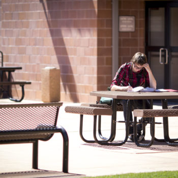 A student studies on campus at TMCC